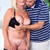 Beautiful grandma Leah L'Amour blows and bangs a gigantic penis while her husband sleeps