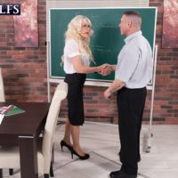Tempting accomplished tutor Dame S seduces a masculine student in an ebony skirt and glasses