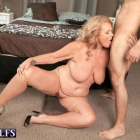 Huge-boobed ash-blonde granny providing blow job on knees before xxx doggie sex