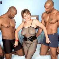 Huge-titted 60 plus MILF Bea Cummins tugging BIG EBONY DICK in multiracial Three-way sex festival