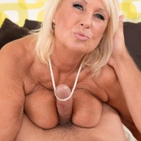 Huge-titted blonde granny in stockings and lingerie providing monster-sized sausage tit fucking and fellatio