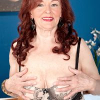 Huge-titted ginger-haired grandmother Katherine Merlot delivering giant dick blowjobs in nylons