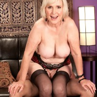 Huge-titted mature pornographic starlet Lola Lee giving blowjobs in pantyhose and lingerie