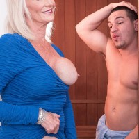 Insatiable Sixty plus MILF Leah L'Amour tempts a younger dude in the sauna before delivering a BLOW JOB