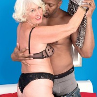Light-haired grandmother Jeannie Lou delivering huge ebony rod multiracial oral job in lingerie