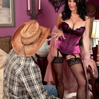 Lingerie and hose outfitted aged X-rated actress Rita Daniels slurping giant prick with tongue