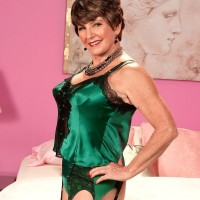 Lingerie and stocking outfitted 60 plus MILF Bea Cummins extracting large older fun bags