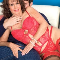 Lingerie attired brown-haired grannie Jacqueline Jolie uncovering immense boobies for nip munching