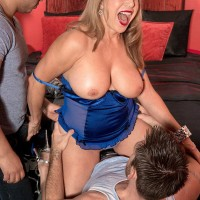 Lingerie outfitted blonde granny Luna Azul baring immense boobs before MMF 3some sex
