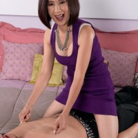 Little Asian grannie Kim Anh demonstrating white lace panties to entice younger man