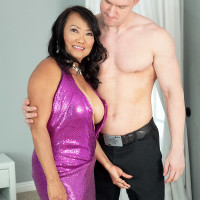 Asian MILF over 60 Mandy Thai seduces a younger hunk in a revealing dress