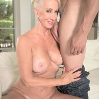 Mature ash-blonde adult video star Madison Milstar releasing large boobs and upskirt panties