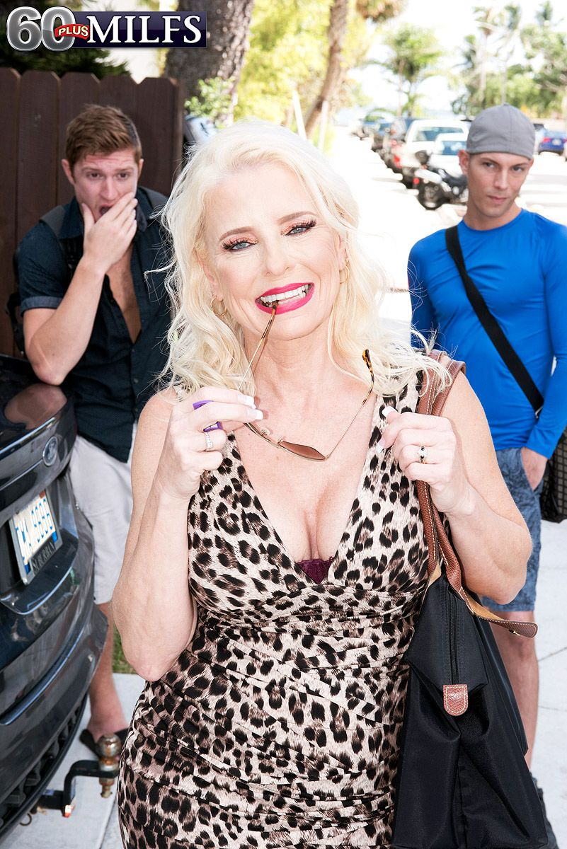MILF over 60 Cammille Austin picks up two boys in an animal print dress and shades