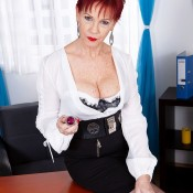 Over 60 businesswoman with red hair Caroline Hamsel seduces a younger guy