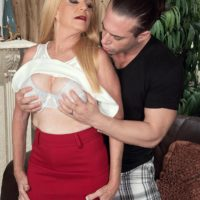 MILF Over 60 Charlie has her big boobs bared by a younger guy in a red miniskirt