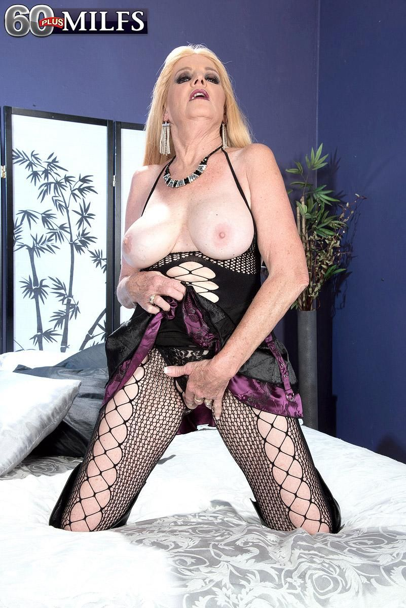 Sexy MILF over 60 Charlie looses her nice tits from a see thru top in leather OTK boots