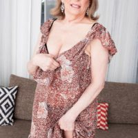 MILF Over 60 Crystal King has her big boobs sucked on a by a younger boy