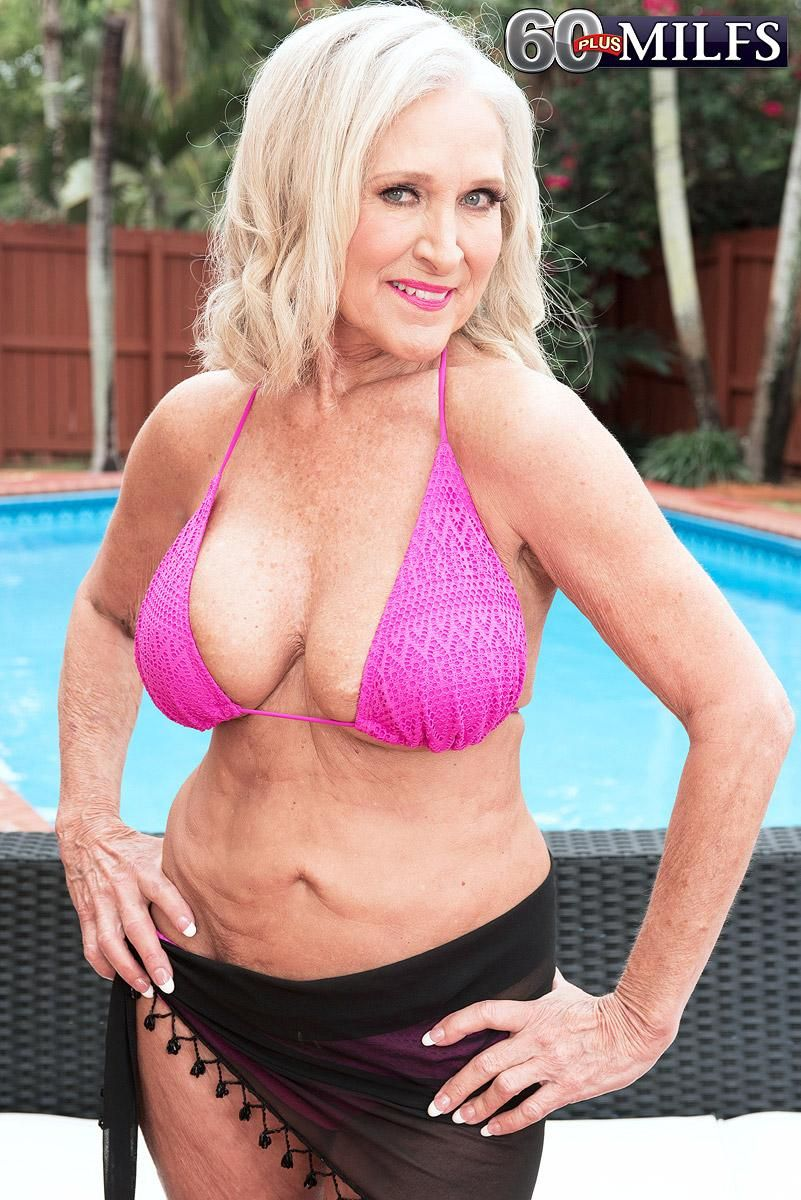 Hot mature MILF Katia has her great tits lubed and rubbed by a younger boy