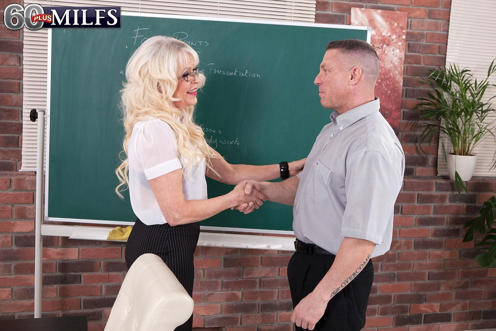 Mature blonde  teacher Lady S seduces a younger gentleman during a class