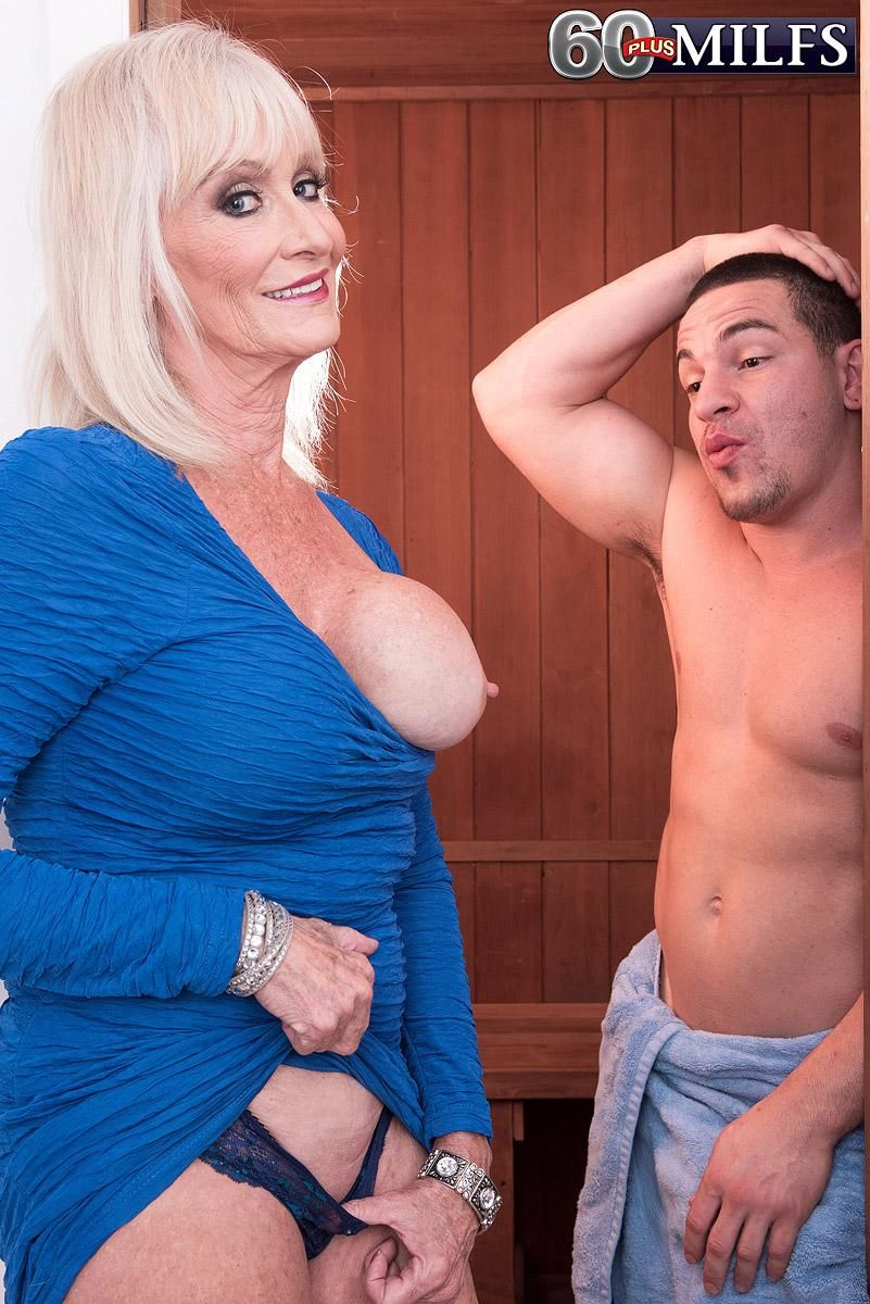 Sexy MILF over 60 Leah L'Amour seduces and blows a younger guy in the sauna