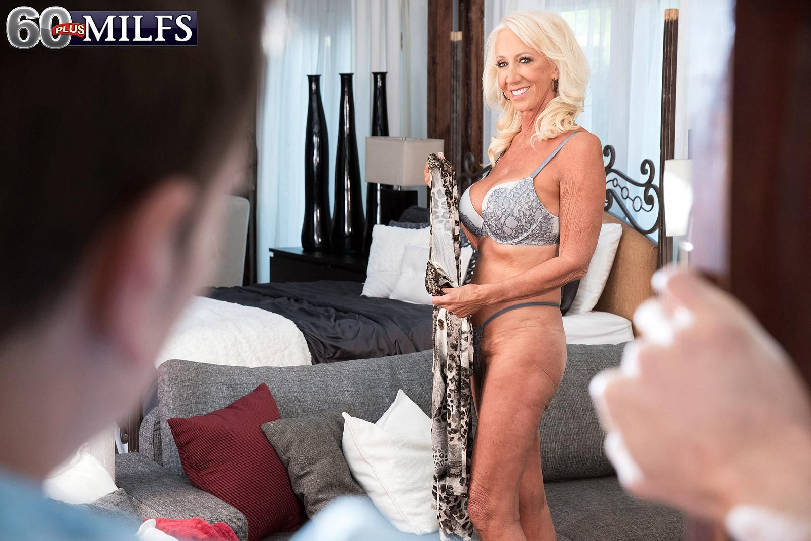 Hot GILF Madison Milstar seduces a young boy at the door in her bra and panties