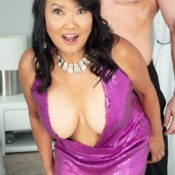 Over 60 Asian MILF Mandy Thai takes her younger lover's hard cock in her hand