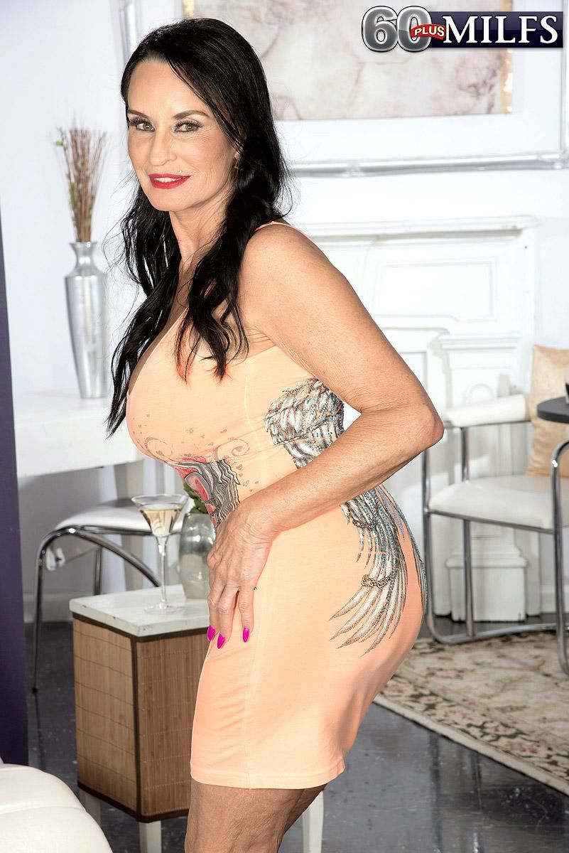 Hot MILF Over 60 Rita Daniels exposes her big boobs while drinking white wine