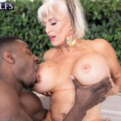 MILF Over 60 Sally D'Angelo has her big tits played with by a muscular black man