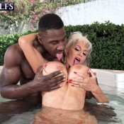 Hot MILF over 60 Sally D'Angelo sucks on a big black dick in outdoor hottub