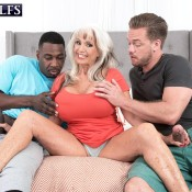 Sexy MILF over 60 Sally D'Angelo sucks big black and white dicks at the same time