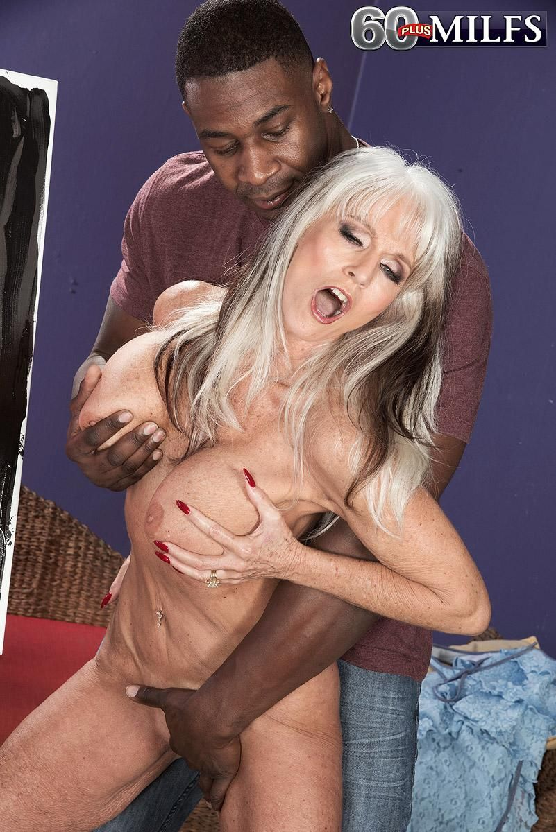 Big titted granny pornstar Sally D'Angelo gets it on with a younger black stud