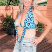 Hot MILF Over 60 Silva Foxx grabs a boy's ass while putting the moves on him