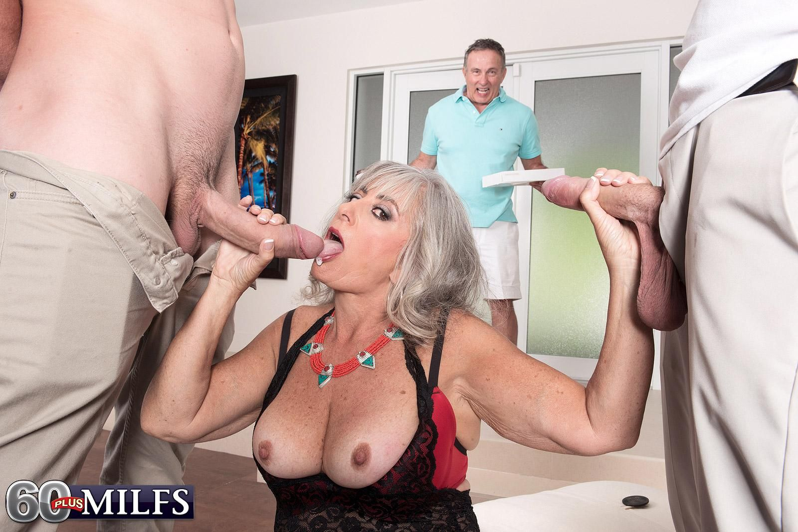 Hot mature MILF Silva Foxx gets caught jerking two cocks by her cuckold hubby