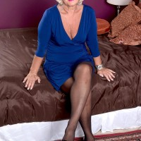 Non nude Sixty plus MILF Jeannie Lou unleashing enormous experienced titties in crotchless panties