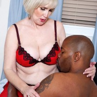 Nylon and lingerie wearing granny Lola Lee delivering gigantic ebony prick BLOWJOB with large hooters out