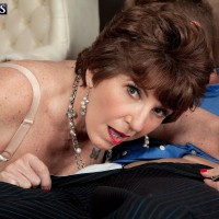 Over 60 MILF Bea Cummins letting monster-sized all-natural boobies fall loose in microskirt and high heeled shoes