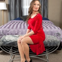 Pantyhose and high heel garmented granny Mona readying for sex with younger man
