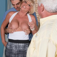 Platinum-blonde grannie Scarlet Andrews unveiling immense knockers before cuckold spouse