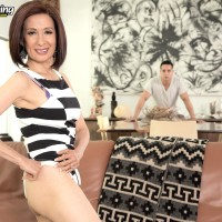 Puny Chinese grandmother Kim Anh undressing down to silk lingerie and thong panty set