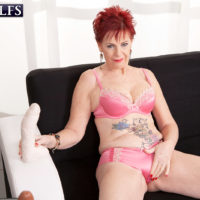 Red-haired granny Caroline Hamsel tongues and deep throats her bevy of sex toys in panties