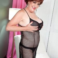 Redhead grandma Gabriella LaMay extracting giant breasts and hard nips from bodystocking