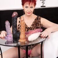 Red-haired grandmother Caroline Hamsel gobbles and blows a bevy of sex toys in undies