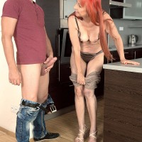 Redheaded grandmother with great legs and giant all-natural boobies delivering hj in kitchen
