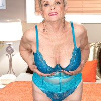 Short haired 60 plus MILF Lin Boyde pulling out huge titties from lingerie in nylons