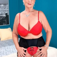 Short haired grandmother Joanne Price seducing younger boy in tights and garter