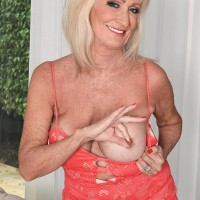 Sixty plus MILF Leah L'Amour seduces a junior guy at the door with her immense hooters out
