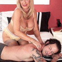 Stocking and lingerie adorned older XXX film starlet Phoenix Skye loosing monster-sized breasts and providing massage