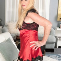 Stocking and lingerie garbed 60 plus platinum-blonde MILF Charlie baring humungous knockers for nip play