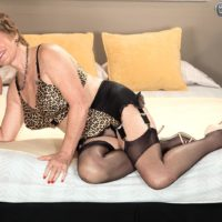 Stocking garmented grannie Bea Cummins providing big black dick HJ in high-heeled shoes and girdle