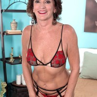 Stocking, garter and lingerie garmented 60 plus MILF Sydni Lane unveiling ass for sex acts